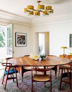 Mid-century dining room inspired with oversized dining table. Whether in the form of painted stripes or tonal wallpaper, an eye-catching ceiling is unique and chic. 15 Astounding Oval Dining Table for Your Modern Dining Room ♥ Discover the season's newest designs and inspirations. Visit us at www.moderndiningtables.net #diningtables #homedecorideas #diningroomideas @ModDiningTables