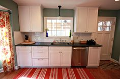 Russet Street Reno: Our finished kitchen - 9 months later;  Behr Lotus Leaf; counters are a quartzite called Phantom Green