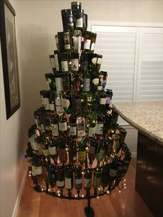 Complete with the room lights on Wine Bottle Christmas Tree, Diy Christmas Tree, Corks, Room Lights, Grape Vines, Wine Rack, Quotes, Home Decor, Bottle Trees