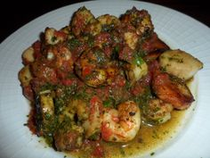 Shrimp and scallops with fresh tomato and garden green sauce