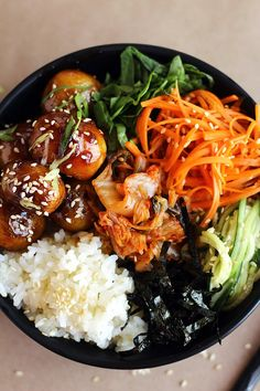 Rich, sweet and savoury Korean style potatoes bowl — with rice, sesame carrots, tangy cucumbers, nori, spinach, and kimchi. Author: Brittany at ilovevegan.com Recipe type: Main course Cuisine: Vega...
