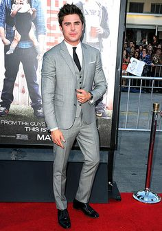 Zac Efron wears a 3-piece suit to the Neighbors premiere in LA.