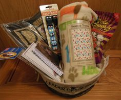 Basket for you and your dog to enjoy!  Includes door mat and throw, dog collars and treats!