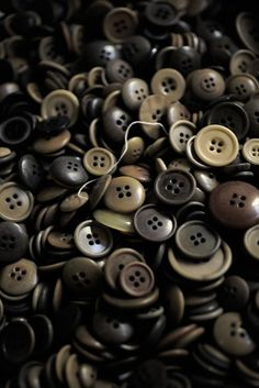 Neutral Buttons    M would love to have a sensory bin filled with buttons!