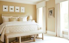 tall window treatment ideas | And the master bedroom has a comfortable seating area, with the ...