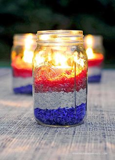 Red, White and Blue Candleholders (via shewearsmanyhats.com) | Easy Fourth of July Outdoor Decor Ideas