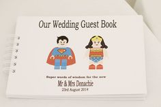 Super Hero Wedding Guest Book - Image by Renata Fry - Rustic Wedding At Buckettsland Farm With Bride In Grecian Style Gown From Coast And Bridesmaids In Silver Dresses From Mint Velvet