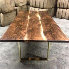 black walnut table with brass base