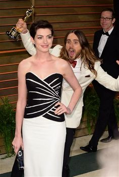 Anne Hathaway and Jared Leto attend the 2014 Vanity Fair Oscar Party at the Sunset Tower Hotel in West Hollywood, Calif., on March 2, 2014.