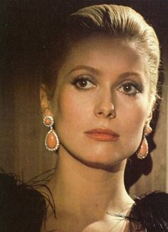 """A woman has to be intelligent, have charm, a sense of humor, and be kind. It's the same qualities I require from a man."" Catherine Deneuve"
