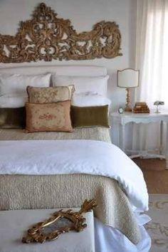 Opulent headboard with simple bedding. Elegant!