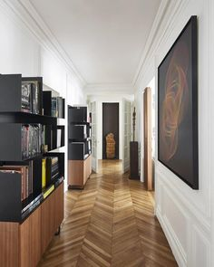 "Transcending classification, architect, furniture designer, and art collector @redaamaloudesign's Paris home is steeped in rich historical references with an eye toward the future. ""I have always assumed that there is no architectural style that I prefer, but there are things I like and do not like,"" he says. In the hallway, a runway of traditional parquet flooring is topped by modern metal and walnut bookshelves designed by Amalou, and an oil on canvas by @sebastien_preschoux adorns the…"