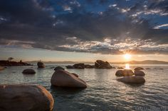 """""""Sunset at Whale Beach, Tahoe 2"""" - Photograph of a sunset at Whale Beach on the East Shore of Lake Tahoe. A man standing on a rock and Whale..."""