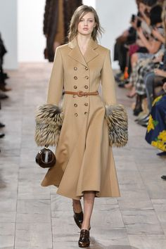 Michael Kors Fall 2015 RTW collection it is easy to see how contemporary fashion takes inspiration from the past. The design depicted here takes inspiration from the 1970's. This design has fur elements, double breast, and is belted is seen in the 1970's. 4/6/15