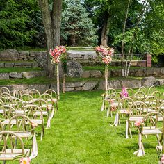 Brides.com: . A single vibrant pink peony adorns each chair at this island-inspired wedding.