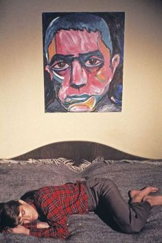 """tomakeyounervous: """"David Bowie """" At home in Berlin, February 1978. Above him is Bowie's own portrait of the Japanese author Yukio Mishima, painted in 1977."""