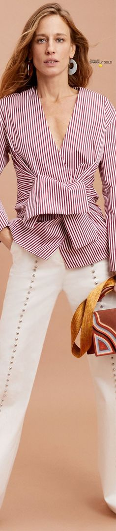 At work it's always best to get to the bottom line. Pin stripes is the classic business print but why not do it in a bold colors and new directions. Pair it with a simple studded leg and watch your results skyrocket.