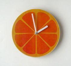 Super fun Orange Wall Clock, $28.80 via uncovet