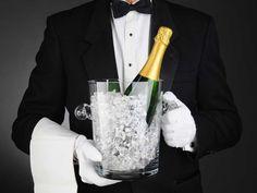 Sommelier with Champagne Ice Bucket. Closeup of a Sommelier holding a Champagne , Champagne Ice Bucket, Champagne Bar, Dark Grey Background, Mini, Black Tie Affair, Glamour, Butler Pantry, Secret Love, Paris