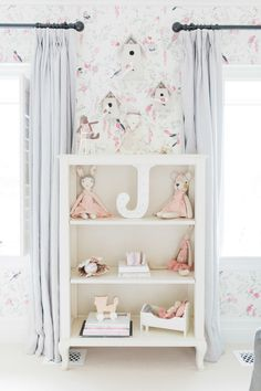 nursery bookcase with whimsical accessories  Photography : Elza Photographie Read More on SMP: http://www.stylemepretty.com/living/2016/06/20/enviable-wallpaper-that-will-take-your-baby-from-tot-to-teen/