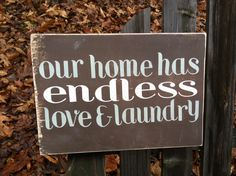 Our home has endless love and laundry. Handmade wooden sign. $20.00, via Etsy.