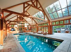 Natatorium by Combined Energy Systems - I love how the wood gives it a cabin feel and the skylights only let light in on one side.  Definitely has the partly indoor partly outdoor vibe.