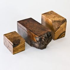 Boxes. Cut to shape and slice off top with a saw. Drill out corners and excess wood. Mark desired depth on drill bit with tape as a guide to keep holes same depth. Clean up and even out hole with sharp wood chisels. Sand and seal. Big style for little cash.