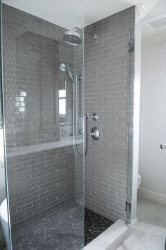 Gray And White Bathroom With Seamless Gl Shower Parion Framing A Tiled Interior Rainfall Head Adjule Over Black