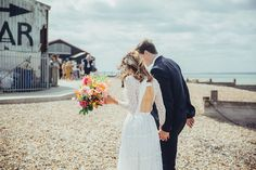 Coastal Wedding at East Quay Venue in Whitstable | Elizabeth Avey Bridal Gown | Bright Orange Florals by Palais Flowers | Doughnut Tower Wedding Cake | Deborah Grace Photography