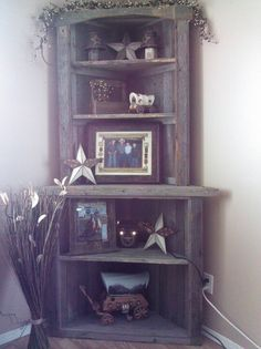 Barn wood corner cabinet. Looks like a 2 Corinthians creation @Scott Becker