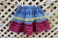 Little Girls Skirt Ethnic Hmong Cranberry and Indigo Batik  With Bright Yellow Pom Poms /// Siamese Dream Designs /// http://www.tafaforum.com/market/kids/