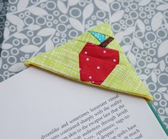 Apple Bookmark- This little apple bookmark is a quick and easy gift. It slides over the corner of a page to keep your place for that light summer reading! Pull out your scrap bin and whip up one (or two or three!) for your favorite teacher.