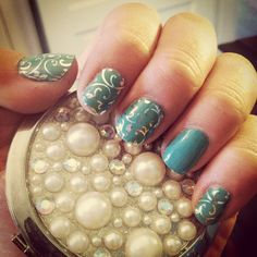I am in love with my new jamicure  What do you think? It is silver floral over Mermaid Jamberry lacquer. Get yours on http://lyndsiepeterson.jamberrynails.net #jamberry #jamberrynails #jamicure #manicure #cutenails #lovemynails #love #diy #moneysaver #silverfloraljn #mermaidjn #poolsideglowjn #picoftheday #nailart #nailwraps #nailselfie