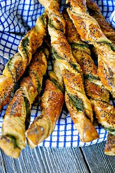 Pesto Black Pepper Pancetta Breadsticks - these crunchy, buttery, puff pastry breadsticks are twisted and layered with all sorts of goodies. From a wonderful Lemon Cashew Pesto I made, to salty, crispy rendered pancetta and then a generous dusting of black pepper.