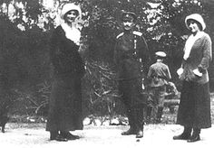 Tatiana and Anastasia with an officer during the captivity; 1917. Alexei is in the background.