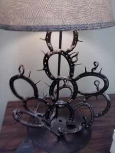 Cactus lamp made out of horse shoes. Or a cactus made for garden art