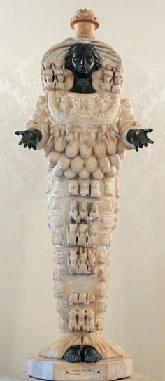 Artemis of Ephesus.  Represents the male half.  The male is generally represented in the circle as the left side, the female, the right side (as you are looking at it) Johan Adkins