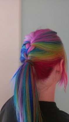 Rainbow hair looks so cool when it's braided. I wouldn't do this, but it does look awesome.