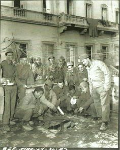 Group of FEB [Brazilian Expeditionary Force] soldiers gather around shell hole on the porch of the FEB command post building. There were no casualties. Italy In November, Mountains In Italy, Brazilian Air Force, Italian Campaign, Learn Brazilian Portuguese, Portuguese Lessons, South American Countries, Oral History, Conflict Resolution