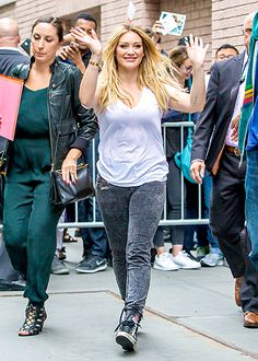 Hilary Duff wore a white v-neck, gray acid wash jeans, and sneakers outside The View in New York City.