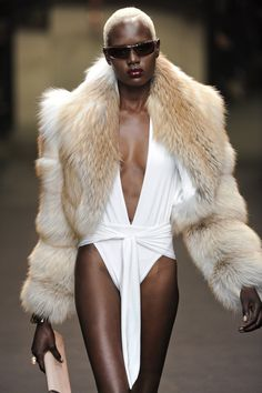 A swimsuit + fur coat, the perfect transitional outfit for fall.