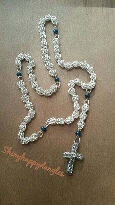 Chainmaile rosary beads. Silver played sweet pea beads and full Persian cross made in aluminum.