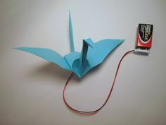 This crane uses HT Flexinol actuator wire to flap (or more accurately, curl) its wings when the circuit is closed.