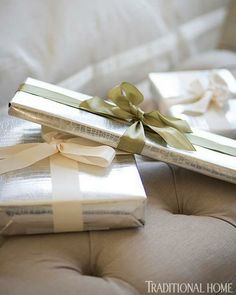 Silver snakeskin wrapping paper is oh-so-chic. - Traditional Home® / Photo: Eric Roth / Design: Tanya Capello