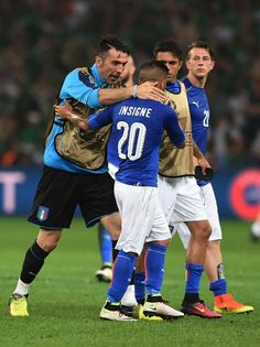 Gianluigi Buffon of Italy consoles Lorenzo Insigne after the UEFA EURO 2016 Group E match between Italy and Republic of Ireland at Stade Pierre-Mauroy on June 22, 2016 in Lille, France.
