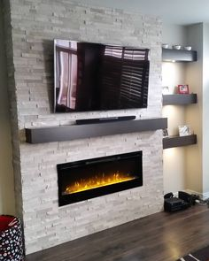 Complete! #fireplace #stone #ibuiltthis #tile #marble #design #waterdown #home #furniture #fireplaces #fire #dimplex #tv by corrienelius