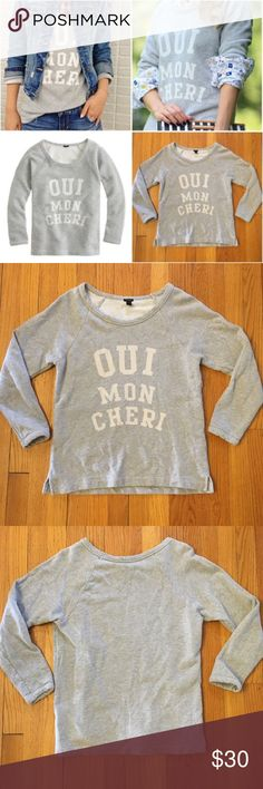 """J. Crew Oui Mon Cheri Sweatshirt Perfect heather grey spring sweatshirt from J. Crew.. Translating to """"yes, my dear,"""" this cheeky sweatshirt is made even more lovable thanks to the cool textured terry fabric. In excellent lightly pre-loved condition. •Slightly loose fit. •Cotton. •Hand wash. No trades. Originally $75. Bundle for a discount. Endless styling options-cover photos show style inspo! J. Crew Tops Sweatshirts & Hoodies"""