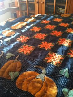 This is such a beautiful quilt.. adding the wool pumpkins for even more detail made it stunning