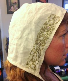A cap made of scrap silk, with embroidery done as a donation for an SCA event.