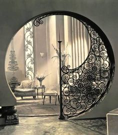 Love the circular archway with the encroaching wrought iron... saw something like this in an old movie one time.